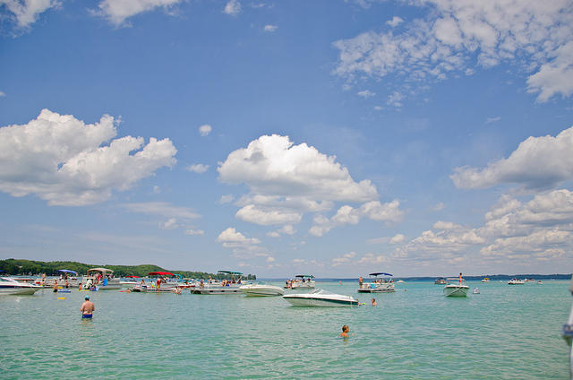 boats and people in Torch lake