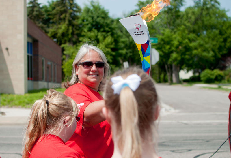 Kelly Higgins, a teacher in the Lewanee School District, carries the torch for the first part.