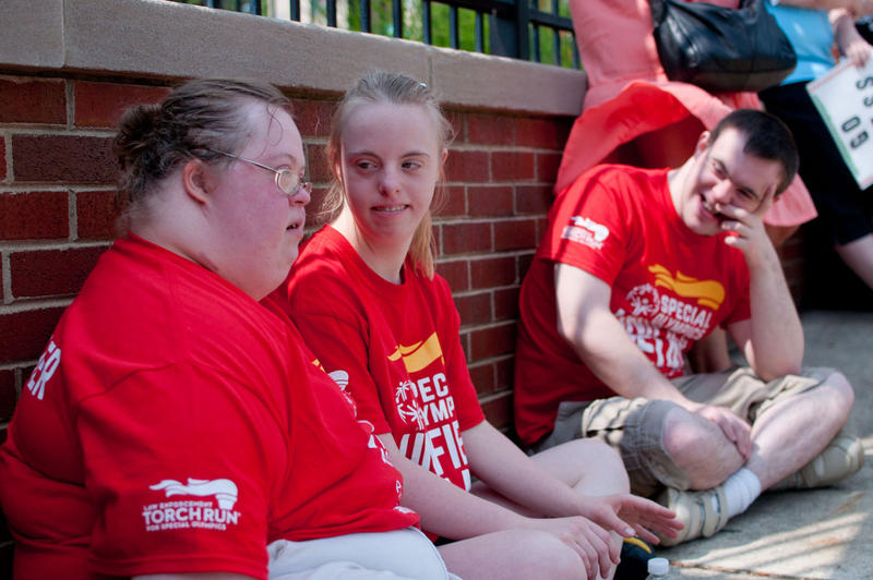 Liz Ceay, Jailynn Borck and Nathan Arno of Lenawee Intermediate School District wait for the Special Olympic World Games torch to arrive at their post.