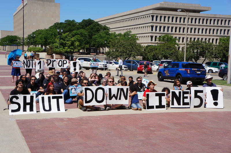 Protesters rallied at the state Capitol on July 30, 2015 demanding that an oil and gas pipeline under the Straits of Mackinac be shut down.