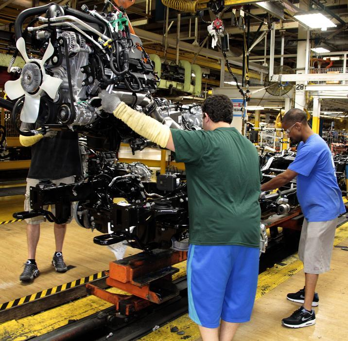 Fiat Chrysler Automobile workers on an assembly line.