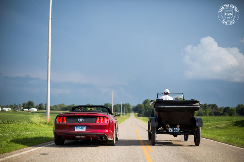The Model T is accompanied by a 2015 Ford Mustang and a Ford F-150.
