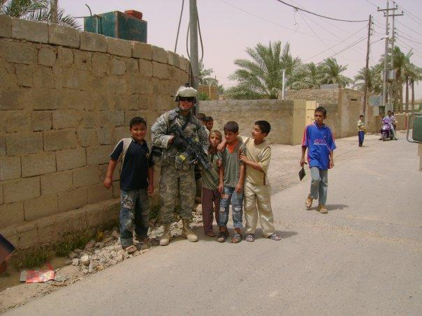 Jason Hale with local children in Ramadi, Iraq