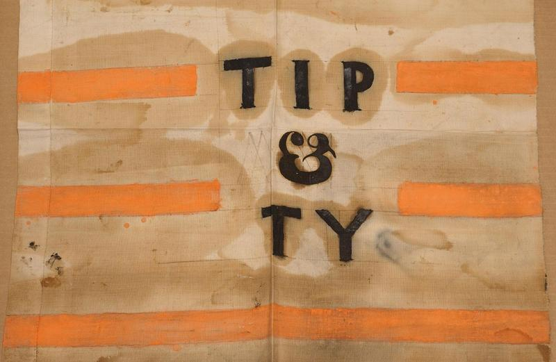 """A campaign banner with a slogan derived from """"Tippecanoe and Tyler Too,"""" used in the 1840 U.S. presidential election."""