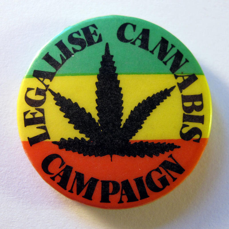 A button promoting marijuana legalization.