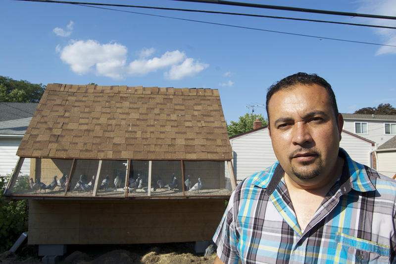 Efrain Zamudio in front of his backyard coop in Allen Park. The Mexican community in Metro Detroit might help carry on the tradition of pigeon racing.