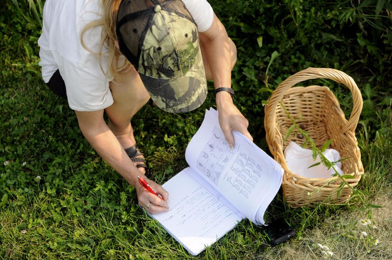 A student takes notes during a Foraging 101 class.