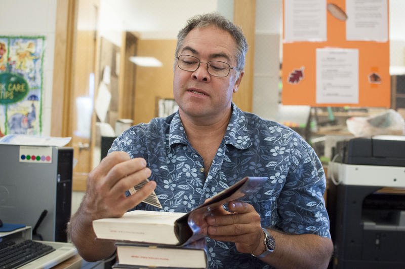 Library assistant Steven King checks out a book. He often helps Amish residents buy Greyhound tickets with his credit card. They pay him back in cash.