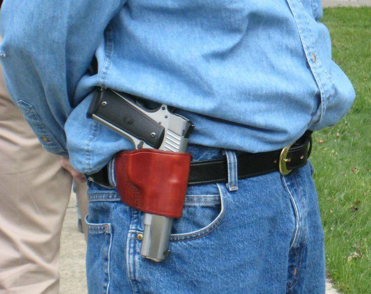 Gun in holster on hip