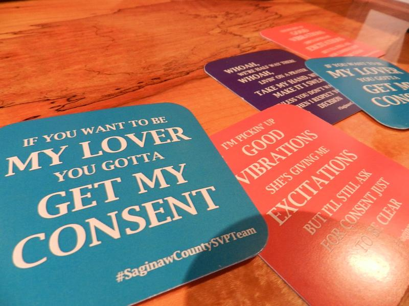 Coasters with sexual assault awareness messages are being distributed this month in Saginaw bars catering to a college age crowd.