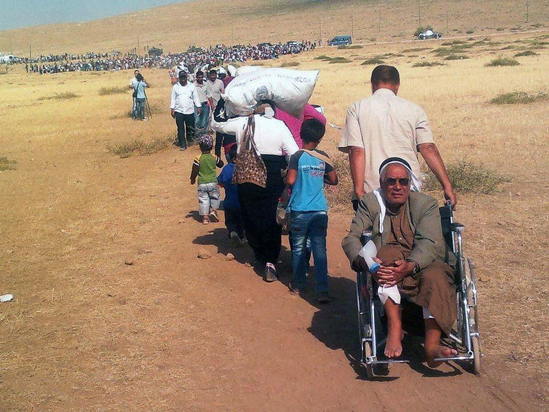 People moving from Syria into Turkey.