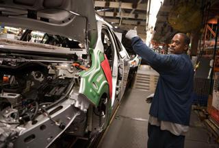 Person working inside General Motors' Hamtramck plant.