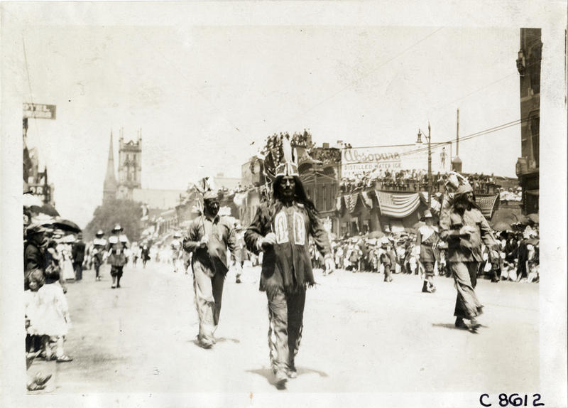The Boston Lodge of the Elks parading on Woodward for the national Elks convention held in 1911 dressed as Indians and pilgrims.