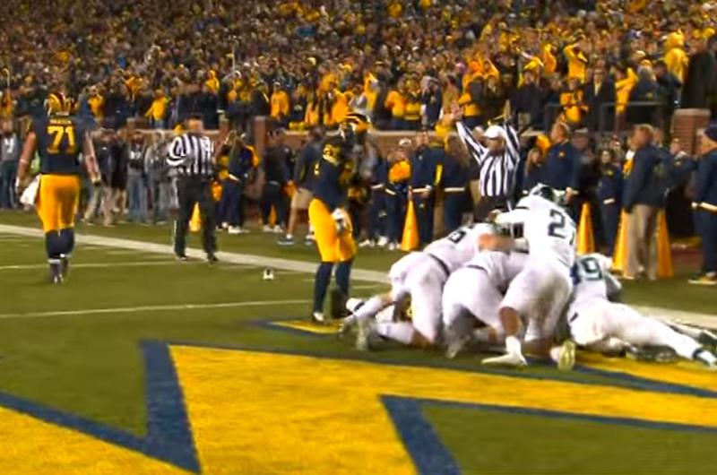 Jalen Watts-Jackson is mobbed by his teammates after scoring the winning touchdown at the Big House. He says the injury occurred when he was tackled by Michigan's Jake Butt.