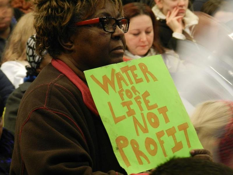 People upset about the safety and quality of Flint's tap water packed a public meeting last January.