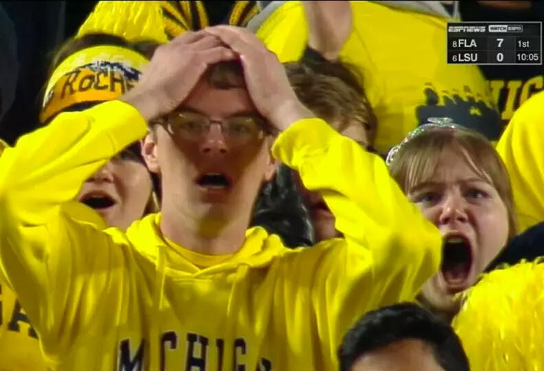 Fans react to the end of the Michigan-Michigan State game on October 17, 2015.