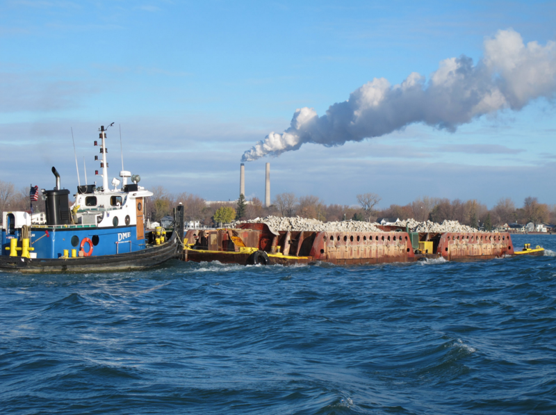 Here a barge transports rock to the Harts Light Reef site in 2014.