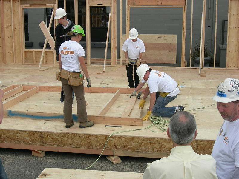 Habitat for Humanity volunteers constructing a house in 2007