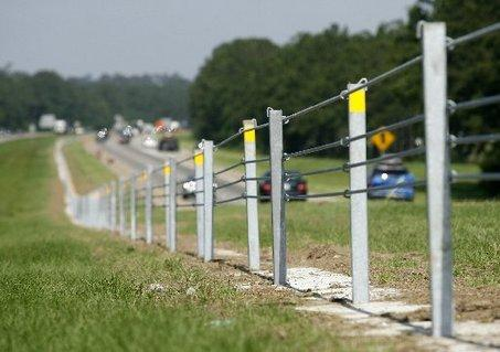 A cable barrier along a highway.