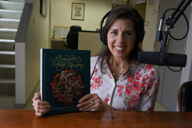 "Maureen Abood with a copy of her cookbook, ""Rose Water & Orange Blossoms"""