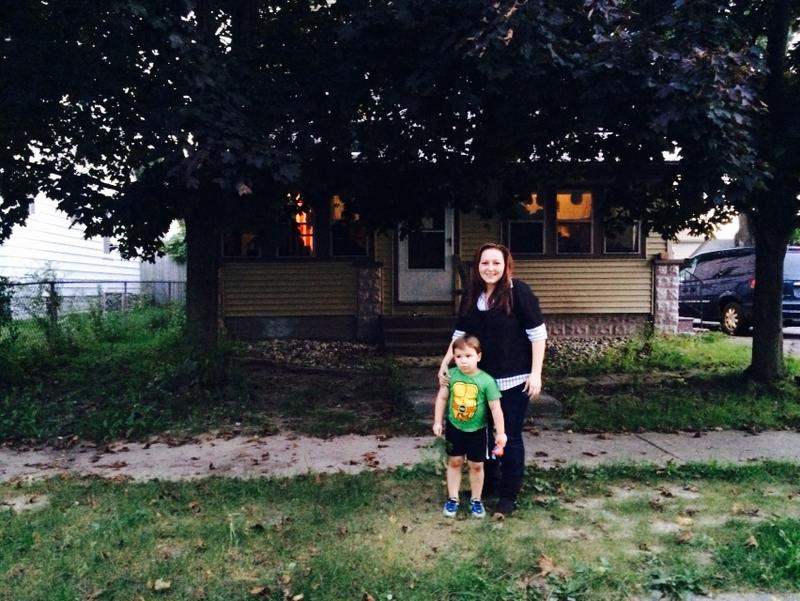 Lee Anne Walters with her son Garrett outside of her home in Flint.