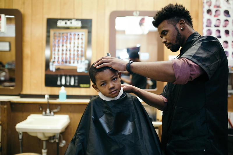 Jayden Hooks gets his haircut by D'Angelo Peete at one of Detroit's oldest barber schools, the Michigan Barber School.