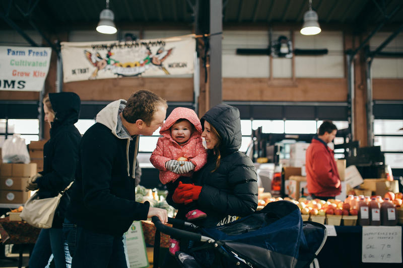 A family enjoys a Saturday morning at the Eastern Market.