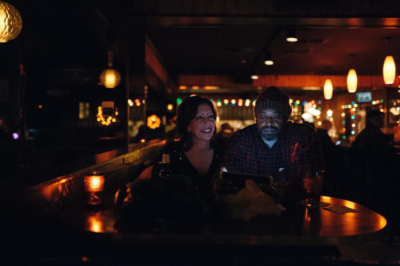 A couple waits for Karaoke to start at Northern Lights Lounge in New Center.