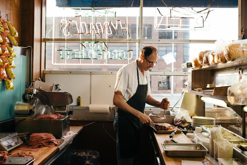 Stuart Litt, owner of Hygrade Deli, prepares breakfast on a chilly Friday morning.