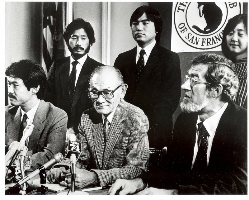 Fred Korematsu, seated center, at a 1983 press conference announcing the reopening of his Supreme Court case