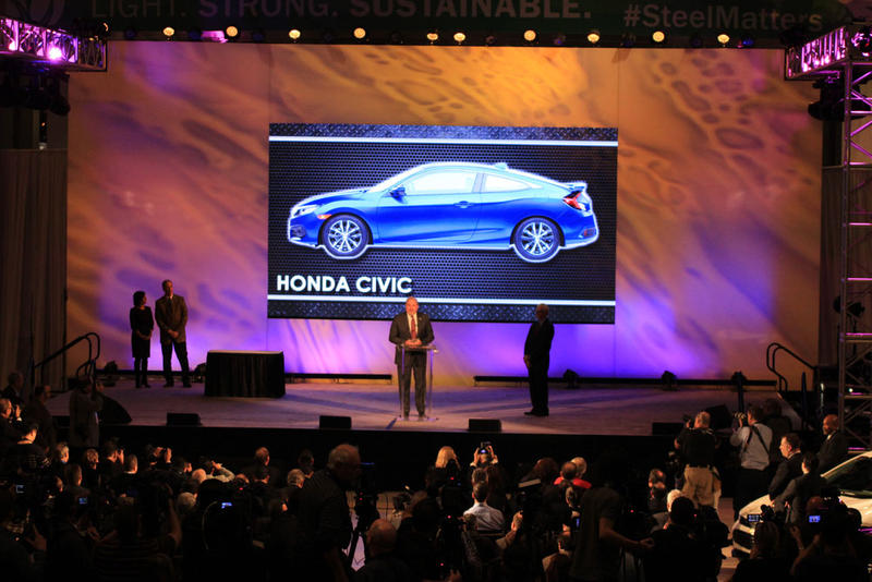 North American President of Honda John Mandell accepts the