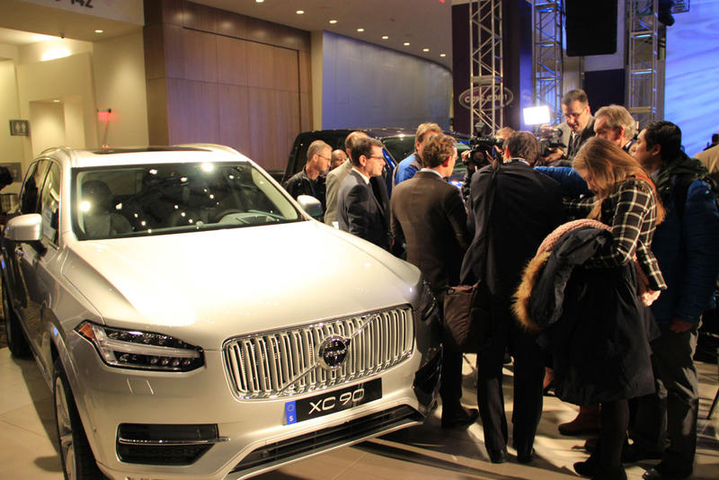 Media gather around the Volvo XC90 at the Detroit Auto Show.