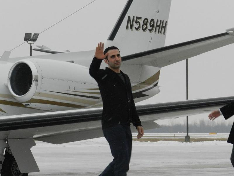 Amir Hekmati steps off a plane at Bishop Airport in Flint.