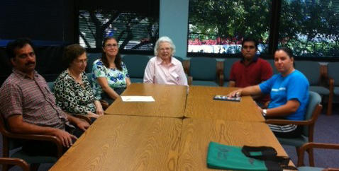 "Ruth Bengtsen (center), the facilitator of ""Talk Time"" at the Troy Public Library, sits with some participants of the program."