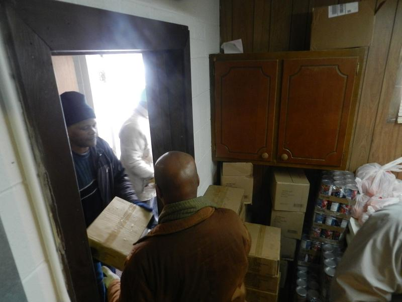 Earlier this year, volunteers from Prince of Peace Missionary Baptist Church in Flint unload fresh produce and boxes of food from a mobile food bank.