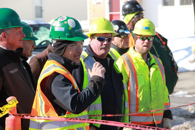 Workers surrounded the site as well.