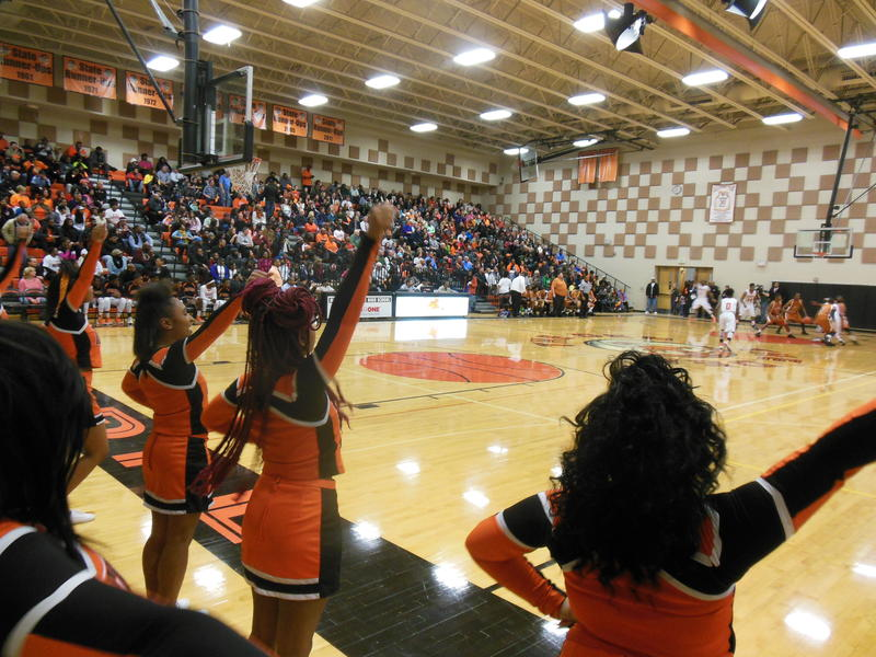 "The seats in the gym at Muskegon Heights High School were packed for a ""unity"" game Wednesday night."