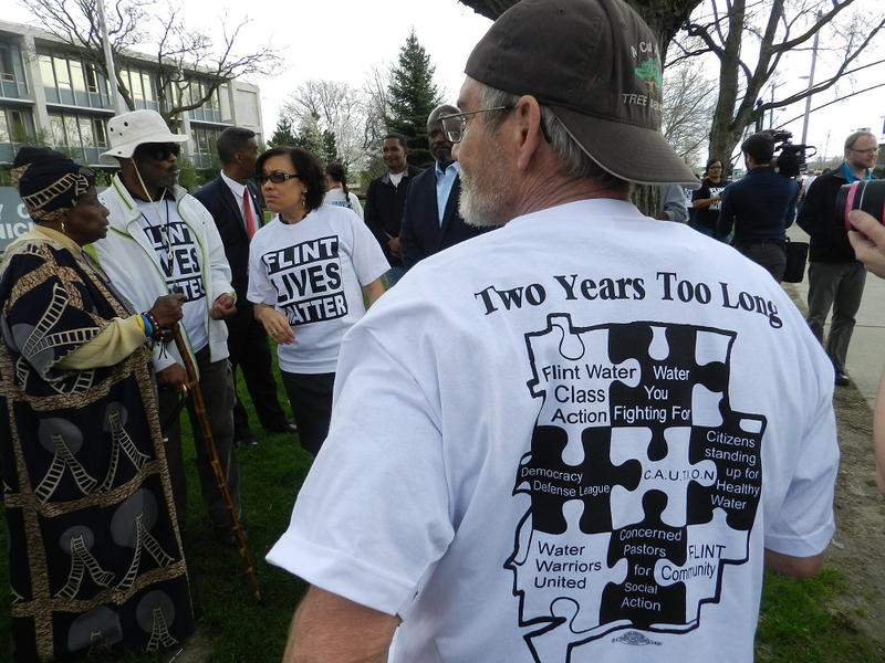 About 75 people gathered on the front lawn of Flint city hall to mark the 2nd anniversary of the city's ill-advised switch to the Flint River as the city's drinking water source
