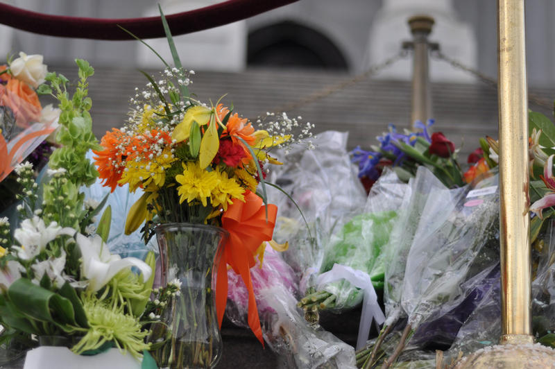 Flowers for the victims of the shooting rampage in Tucson, Ariz., on display of the steps of the Capitol in 2011.