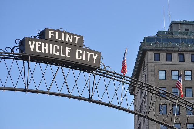 "sign that says ""Flint Vehicle City"""