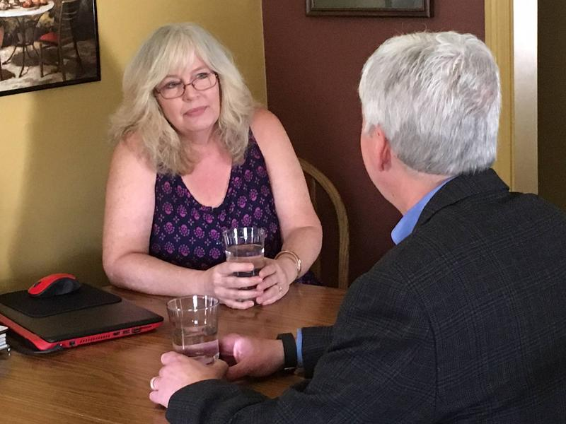 Governor Snyder sits with Flint resident Cheryl Canty in her home on Monday