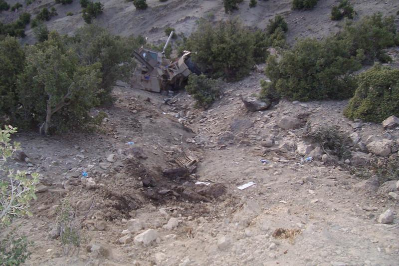 This picture shows a humvee that was blown off the road in Afghanistan. Sgt. Anthony Gazvoda pulled the driver out of the car while taking enemy fire.