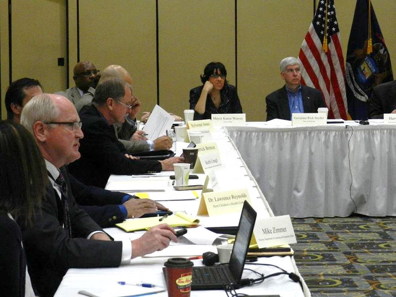Sub Committee chair Mike Zimmer (lower left) delivers a report on new lead/copper testing as members of the governor's special Flint water team listen, including Gov. Rick Snyder and Flint Mayor Karen Weaver