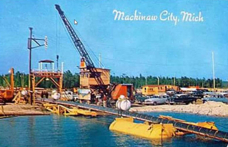 A postcard from 1953 shows Line 5 being installed in the Straits of Mackinac. The group says it's proof the easement wasn't followed in the first place. Enbridge says that's not true.