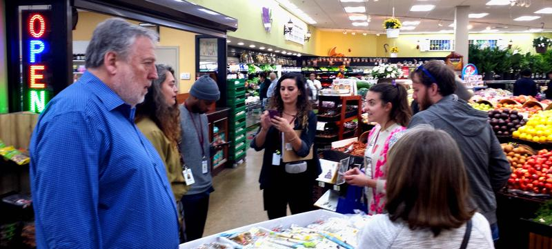 "A small group taking the ""Yala Eat!"" tour offered by the Arab American National Museum. The first stop was Dearborn Fresh, a grocery store which caters to Dearborn's Arab American residents."