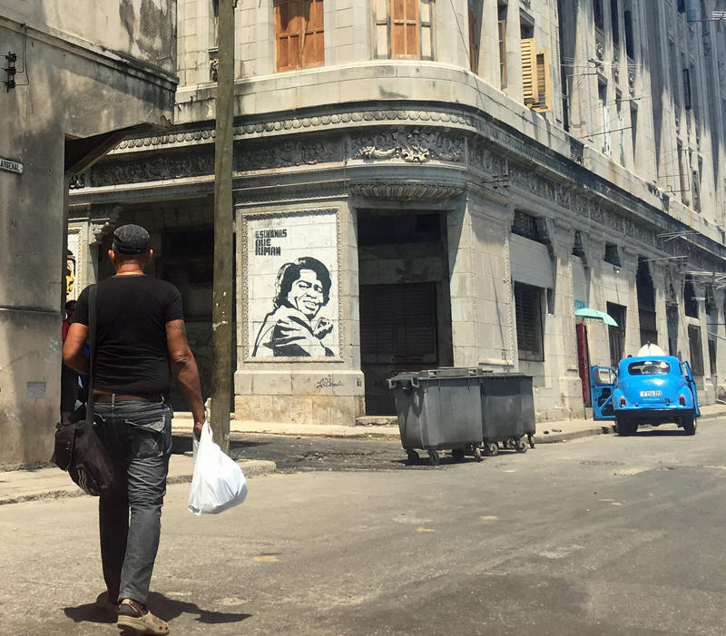 "James Brown appears in a poster on a street corner in Old Habana with the slogan ""corners that rhyme."""