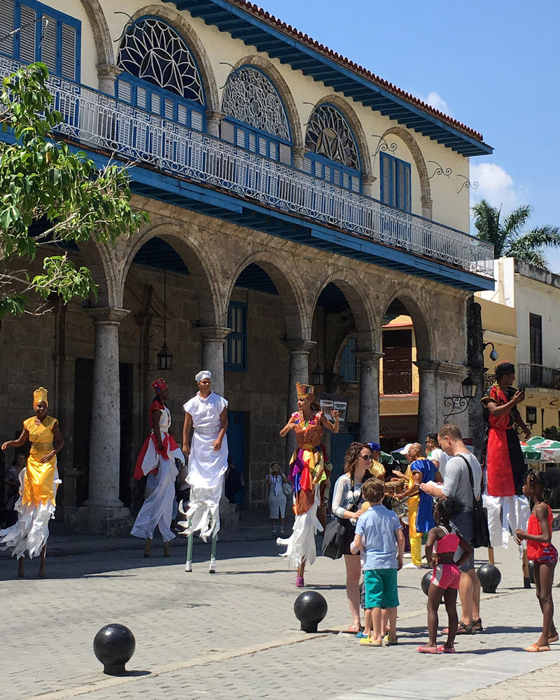 Stilt dancers entertain visitors at Plaza Vieja in Havana.