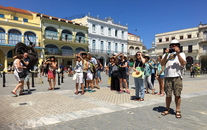 Tourists snap photos of Plaza Vieja in Old Havana.