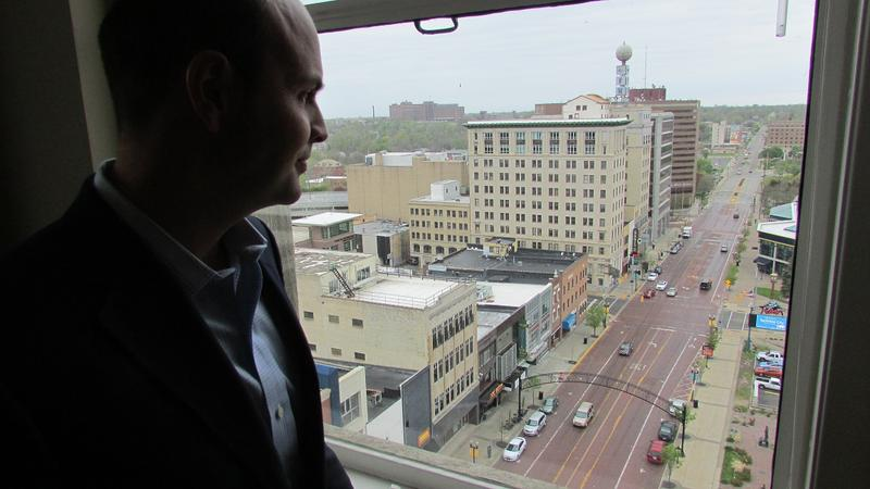 Ridgway White, President of the C.S. Mott Foundation, looks out at downtown Flint from his 12th floor office