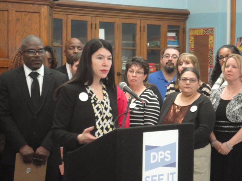 Alycia Meriweather announces the district's new offerings at Detroit's Cooke Elementary School.